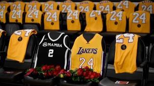 The jerseys of late Los Angeles Laker Kobe Bryant, right, and his daughter Gianna are draped on the seats the two last sat on at Staples Center, prior to the Lakers' NBA basketball game against the Portland Trail Blazers in Los Angeles, Friday, Jan. 31, 2020. The last game two attended was on Dec. 29, 2019 when the Lakers faced the Dallas Mavericks. (AP Photo/Kelvin Kuo)