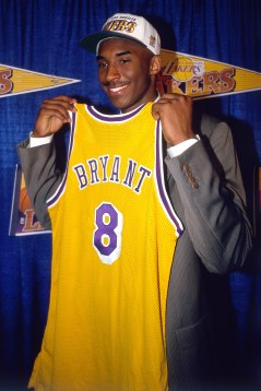 INGLEWOOD, CA - JULY 11: Kobe Bryant holds a #8 Los Angeles Lakers jersey after being the 13th overall pick in the 1996 NBA Draft by the Charlotte Hornets who then traded his draft rights to the Los Angeles Lakers on July 11, 1996 in Inglewood, California. NOTE TO USER: User expressly acknowledges and agrees that, by downloading and/or using this Photograph, user is consenting to the terms and conditions of the Getty Images License Agreement. Mandatory Copyright Notice: Copyright 1996 NBAE (Photo by Juan Ocampo/NBAE via Getty Images)
