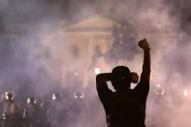 A Protesting Fist in the Midst of Smoke