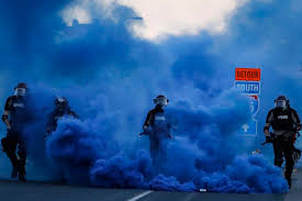 Smoke Bomb Cops In Riot Gear