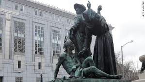 Statue of a Colonizer & Christian Subduing Native American