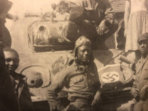 """HANDOUT - James Baldwin, center, fought in World War II, helping to liberate the Netherlands. His job in the Army battalion was to give the orders from the tank. They used an 81 MM mortar gun that fires long range. """" We came in and freed them,"""" Baldwin said. """"We liberated them. We ran the Germans out. We took 23 cities in three days. We were moving fast. That's called liberation."""" He received a certificate of appreciation and gifts from the embassy of the Netherlands February 6, 2020. Baldwin, 95, served in the 784th Tank Battalion during the war. (Family photo)"""