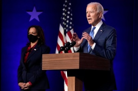 Democratic vice presidential candidate Sen. Kamala Harris, D-Calif., listens as Democratic presidential candidate former Vice President Joe Biden speaks Friday, Nov. 6, 2020, in Wilmington, Del. (AP Photo/Carolyn Kaster)