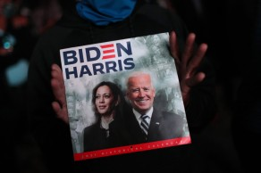 WILMINGTON, DELAWARE - NOVEMBER 07: A supporter of President-elect Joe Biden shows a calendar with Biden and Vice President-elect Kamala Harris on cover outside the Chase Center where Biden addressed the nation November 07, 2020 in Wilmington, Delaware. After four days of counting the high volume of mail-in ballots in key battleground states due to the coronavirus pandemic, the race was called for Biden after a contentious election battle against incumbent Republican President Donald Trump. (Photo by Joe Raedle/Getty Images)