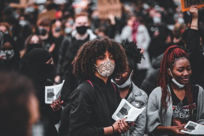 Featured Women Holding Black Power Fist Papers