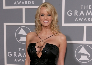 FILE - In this Feb. 11, 2007, file photo, Stormy Daniels arrives for the 49th Annual Grammy Awards in Los Angeles. President Donald Trump's personal attorney says he paid $130,000 out of his own pocket to a porn actress who allegedly had a sexual relationship with Trump in 2006. Michael Cohen tells The New York Times he was not reimbursed by the Trump Organization or the Trump campaign for the payment to Stormy Daniels, whose real name is Stephanie Clifford. (AP Photo/Matt Sayles, File)