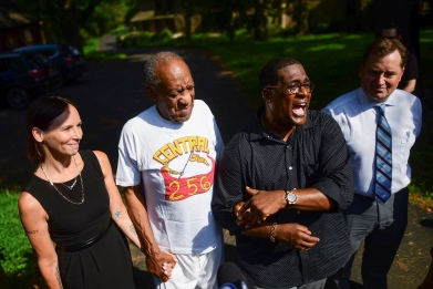 Bill Cosby stands next to his spokesman Andrew Wyatt outside Cosby's home after Pennsylvania's highest court overturned his sexual assault conviction and ordered him released from prison immediately, in Elkins Park, Pennsylvania, U.S., June 30, 2021. REUTERS/Mark Makela